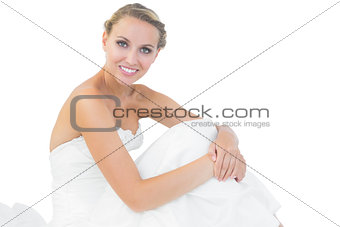 Beautiful bride sitting on floor