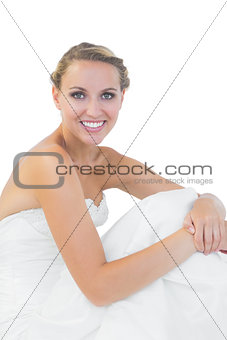 Cute young bride sitting on floor