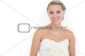 Attractive blonde bride posing and smiling at camera