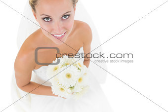 Smiling blonde bride looking up at the camera