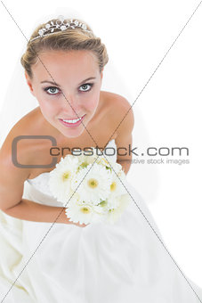 Beautiful young bride holding a bouquet