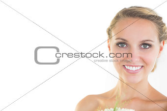 Beautiful young bride smiling at camera