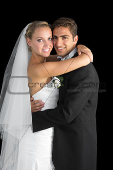 Beautiful bride hugging her husband