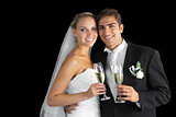 Sweet young couple posing with champagne glasses