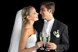 Cheerful married couple holding champagne glasses