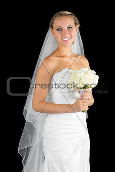Beautiful young bride posing holding a bouquet