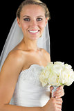 Happy blonde bride posing smiling at camera