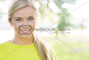Fit smiling blonde looking at camera
