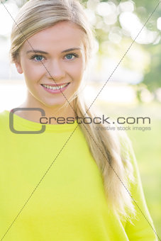 Fit cheerful blonde looking at camera