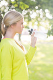 Fit calm blonde holding water bottle