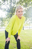 Active smiling blonde pausing after a run