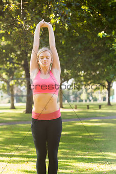 Active peaceful blonde doing yoga exercise