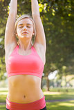 Active calm blonde doing yoga exercise
