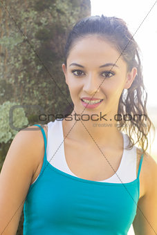 Active happy brunette looking at camera