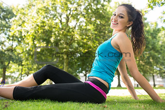Active smiling brunette enjoying the sun