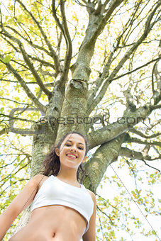 Active happy brunette smiling at camera