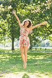 Stylish smiling brunette jumping in the air