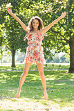 Stylish gorgeous brunette jumping in the air