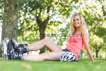 Casual smiling blonde wearing roller blades