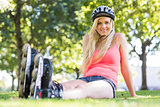 Casual cheerful blonde wearing roller blades