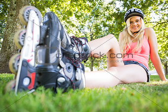 Casual attractive blonde wearing roller blades and helmet