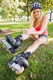 Casual gorgeous blonde wearing roller blades and helmet