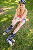 Casual content blonde wearing roller blades and helmet