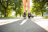 Close up of woman wearing inline skates standing on pathway