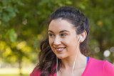 Cheerful cute woman listening to music
