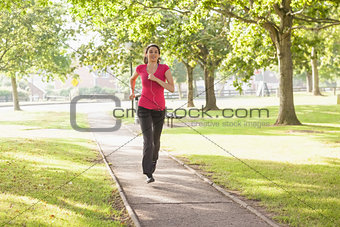 Sporty woman running in a park
