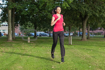 Beautiful woman running in a park