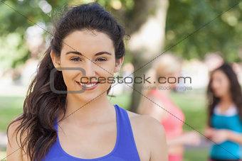 Beautiful sporty woman posing in a park