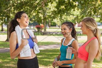 Three pretty sporty friends chatting