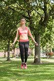 Blonde sporty woman skipping