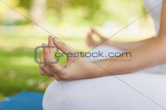 Close up of young woman meditating