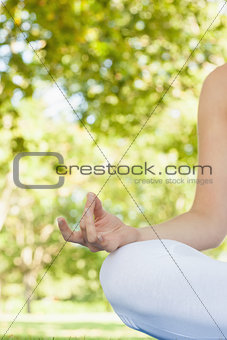Close up of meditating young woman