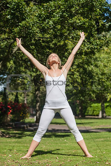Blonde woman doing yoga in a park