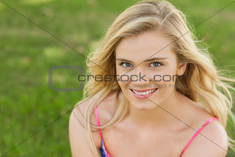 High angle view of beautiful young woman smiling at camera