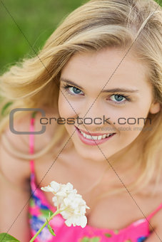 Portrait of lovely woman holding a white flower
