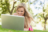 Happy blonde woman working with her notebook