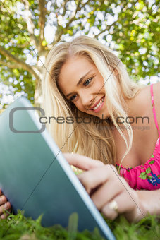 Lovely young woman using her tablet