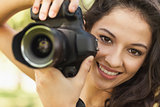 Gorgeous calm woman holding her camera