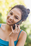 Portrait of amused young woman phoning