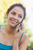 Lovely brunette woman calling with her smartphone