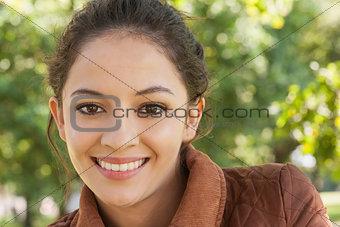 Portrait of beautiful brunette woman wearing a coat