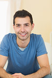 Casual smiling man relaxing on couch