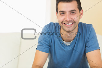 Casual cheerful man relaxing on couch