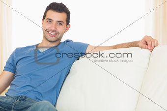 Casual happy man relaxing on couch