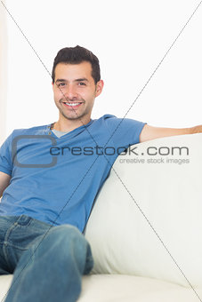 Casual content man relaxing on couch