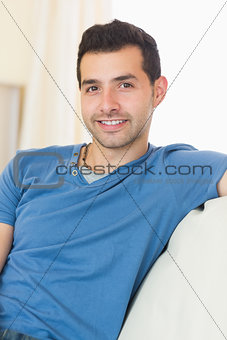 Casual handsome man relaxing on couch